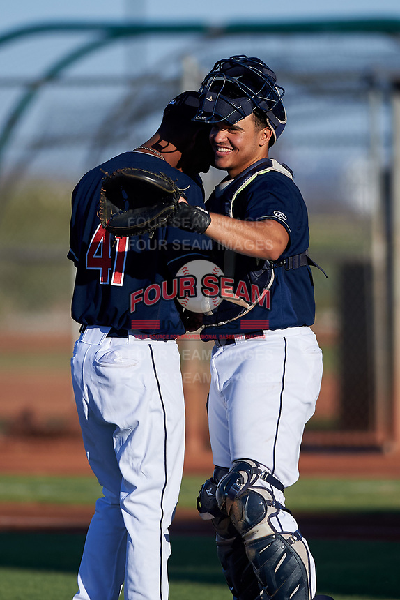 AZL Indians Red starting pitcher Brauny Munoz (41) and catcher Yainer Diaz (4) laugh during an Arizona League game against the AZL Padres 1 on June 23, 2019 at the Cleveland Indians Training Complex in Goodyear, Arizona. AZL Indians Red defeated the AZL Padres 1 3-2. (Zachary Lucy/Four Seam Images)