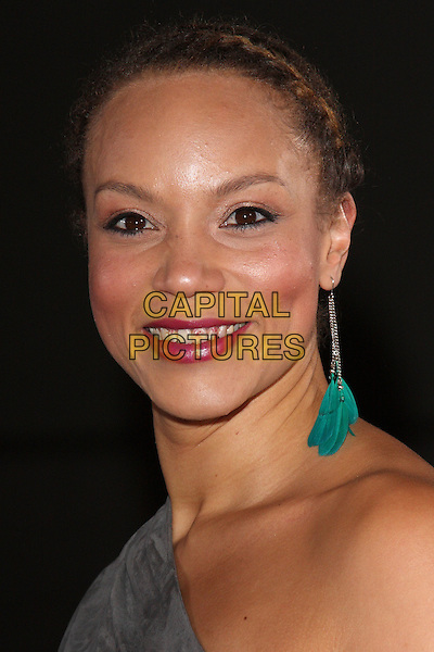 ANGELA GRIFFIN.Variety Club Showbiz Awards held at the Grosvenor House Hotel, Park Lane, London, England..November 15th, 2009.headshot portrait one shoulder grey gray feather earring dangly hair up lipstick on teeth funny.CAP/ROS.©Steve Ross/Capital Pictures.