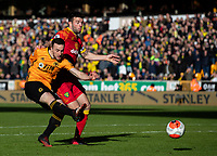 Wolverhampton Wanderers' Diogo Jota shoots at goal under pressure from Norwich City's Grant Hanley<br /> <br /> Photographer Alex Dodd/CameraSport<br /> <br /> The Premier League - Wolverhampton Wanderers v Norwich City - Sunday 23rd February 2020 - Molineux - Wolverhampton<br /> <br /> World Copyright © 2020 CameraSport. All rights reserved. 43 Linden Ave. Countesthorpe. Leicester. England. LE8 5PG - Tel: +44 (0) 116 277 4147 - admin@camerasport.com - www.camerasport.com