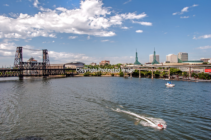 A beautiful summer day on the Willamette River waterfront in Portland, Oregon.