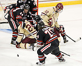 Dax Lauwers (NU - 44), Bill Arnold (BC - 24), Cody Ferriero (NU - 79), Kevin Hayes (BC - 12) - The Boston College Eagles defeated the visiting Northeastern University Huskies 3-0 after a banner-raising ceremony for BC's 2012 national championship on Saturday, October 20, 2012, at Kelley Rink in Conte Forum in Chestnut Hill, Massachusetts.
