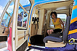 2 August 2009: Passenger Sally Herschorn gets ready for a scenic tour in a helicopter operated by Blue Skies Charter Service prior to a flight above the Caribbean town of Willemstad, on the island of Curacao, in the Netherlands Antilles. Curaçao is known for tourism, scuba diving, and technologically advanced business districts. Mandatory Photo Credit: Ed Wolfstein Photo