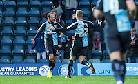 Jason McCarthy of Wycombe Wanderers runs to celebrate Michael Harriman (left)  of Wycombe Wanderers goal making it 1-0 during the Sky Bet League 2 match between Wycombe Wanderers and Portsmouth at Adams Park, High Wycombe, England on 28 November 2015. Photo by Andy Rowland.