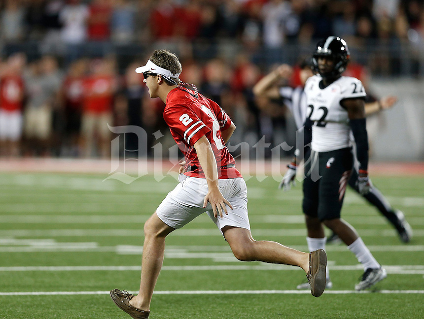 A fan runs on the field during the second quarter of Saturday's NCAA Division I football game at Ohio Stadium in Columbus on September 27, 2014. (Columbus Dispatch photo by Jonathan Quilter)