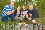 "3354-3356.---------.Taking Care.-----------.Rhys LLywelyn(Rt)of Cappanalea Outdoor Education Centre show Caoimhin O'Neill(Castlegregory)Alice McDonald(Tarbert)and Sandra O'Neill how to ""Leave no trace"" when having a fire out in the countryside."