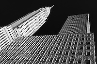 The Chrysler Building rises above NYC in black and white.