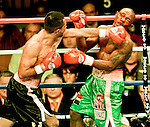 Carlos Navarro,(Blk Trk) of Los Angeles, vs Agapito Sanchez, of the Dominican Republic for their WBC Continental Americas junior lightweight championship fight on Saturday, Dec. 11, 2004, at the Mandalay Bay Events Center in Las Vegas. Navarro won by TKO in the eleventh round..Larry Burton