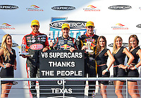 May 19, 2013 Fabian Coulthard #14 of Lockwood Racing , Jamie Whincup #1 of Triple Eight Engineering, Shane Van Gisbergen #97 of TEKNO Team VIP  and victory stand hostess pose for a photograph at the conclusion of V8 Supercars race 16 on day three of Austin 400 in Austin, TX.