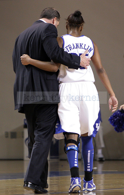 Senior Guard Amani Franklin talking with coach Mitchell in the first half. Photo by William Baldon | Staff
