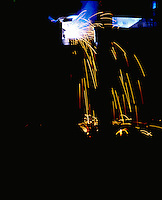 Welders sparks on a black background.