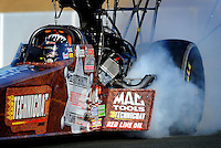 Jul. 16, 2010; Sonoma, CA, USA; Smoke comes from the engine on the car of NHRA top fuel dragster driver Doug Kalitta after exploding an engine during qualifying for the Fram Autolite Nationals at Infineon Raceway. Mandatory Credit: Mark J. Rebilas-