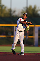 Fernery Ozuna (9) of the Hillsboro Hops throws during a game against the Salem-Keizer Volcanoes at Ron Tonkin Field on July 27, 2015 in Hillsboro, Oregon. Hillsboro defeated Salem-Keizer, 9-2. (Larry Goren/Four Seam Images)