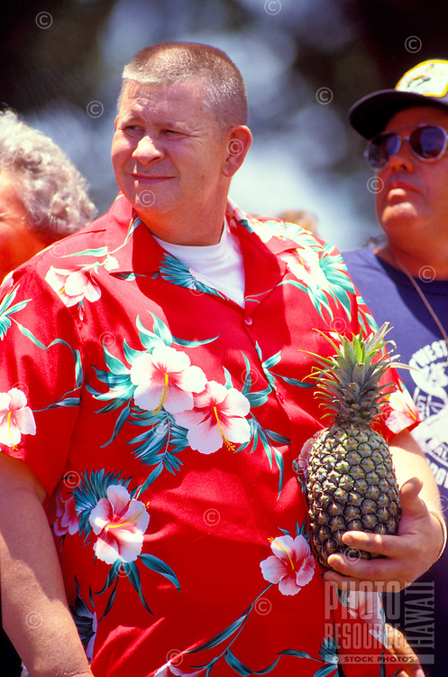 Tourist in aloha shirt with pineapple