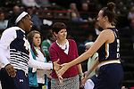 18 February 2016: Notre Dame head coach Muffet McGraw (center) intercepts a handslap from Michaela Mabrey (right). The Wake Forest University Demon Deacons hosted the University of Notre Dame Fighting Irish at Lawrence Joel Veterans Memorial Coliseum in Winston-Salem, North Carolina in a 2015-16 NCAA Division I Women's Basketball game. Notre Dame won the game 86-52.