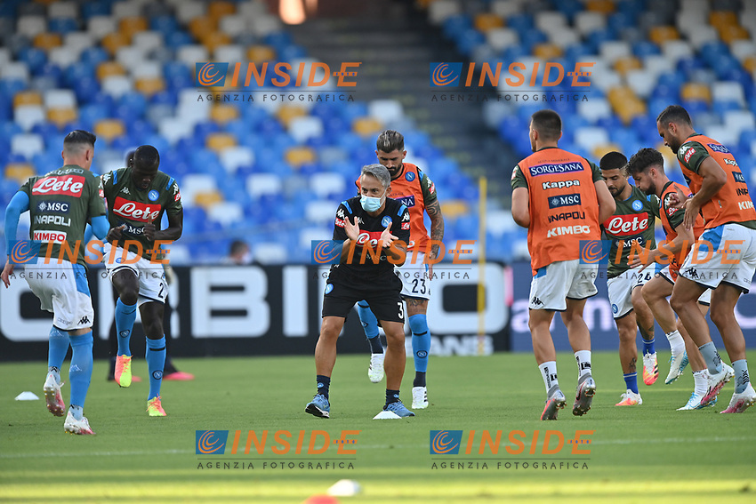 SSC Napoli players during the warm up prior the Serie A football match between SSC  Napoli and SPAL at stadio San Paolo in Naples ( Italy ), June 28th, 2020. Play resumes behind closed doors following the outbreak of the coronavirus disease. <br /> Photo Carmelo Imbesi / Insidefoto
