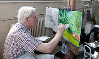 Artist using a mahl stick to give a steady hand, Life Drawing Class, Adult Learning Centre, Guildford, Surrey.