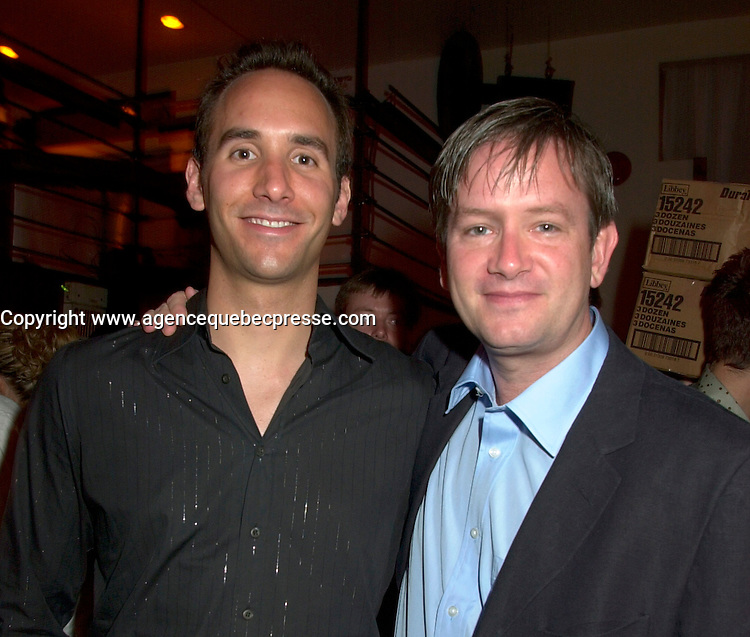 June 4 2002, Montreal, Quebec, Canada<br /> <br /> Humorist Mark Mckinney (R) and his producer<br /> Michael Shore (L) enjoy a party at ilume club, in Montreal, JUne 4, 2002 after the opening of McKinney's play ; Fully Committed.<br /> <br /> Formelly of The Kids In The Hall Canadian TV show, McKinney now based in New York, plays in movies and TV series such as DICE, Brain Candy, ... as well as doing comedy and theater.<br /> <br /> Mandatory Credit: Photo by Pierre Roussel- Images Distribution. (&copy;) Copyright 2002 by Pierre Roussel <br /> <br /> NOTE :l Nikon D-1 jpeg opened with Qimage icc profile, saved in Adobe 1998 RGB.