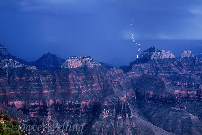 749220222 a powerful lightning bolt strikes near wotans throne and zoster temple on the north rim of grand canyon national park in arizona