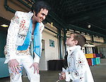 Bryant Scott (left) of Montreal, Quebec has an Elvis to Elvis talk with Drew Ahearn, 6 of Crofton before they perform at the Ultimate Elvis Tribute Contest at Prince George's Stadium in Bowie on Saturday afternoon.