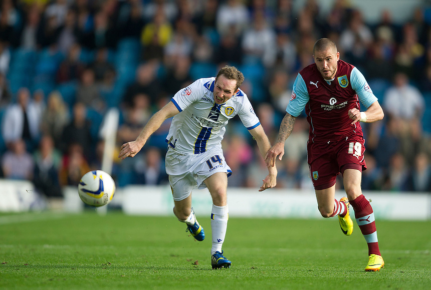 Burnley's Michael Kightly and Leeds United's Aidan White in a chase for possession <br /> <br /> Photo by Stephen White/CameraSport<br /> <br /> Football - The Football League Sky Bet Championship - Leeds United v Burnley - Saturday 21st September 2013 - Elland Road - Leeds<br /> <br /> &copy; CameraSport - 43 Linden Ave. Countesthorpe. Leicester. England. LE8 5PG - Tel: +44 (0) 116 277 4147 - admin@camerasport.com - www.camerasport.com