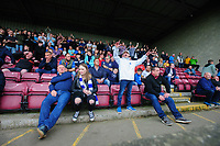 Peterborough United fans watch their team in action <br /> <br /> Photographer Chris Vaughan/CameraSport<br /> <br /> The EFL Sky Bet League One - Scunthorpe United v Peterborough United - Saturday 13th October 2018 - Glanford Park - Scunthorpe<br /> <br /> World Copyright © 2018 CameraSport. All rights reserved. 43 Linden Ave. Countesthorpe. Leicester. England. LE8 5PG - Tel: +44 (0) 116 277 4147 - admin@camerasport.com - www.camerasport.com