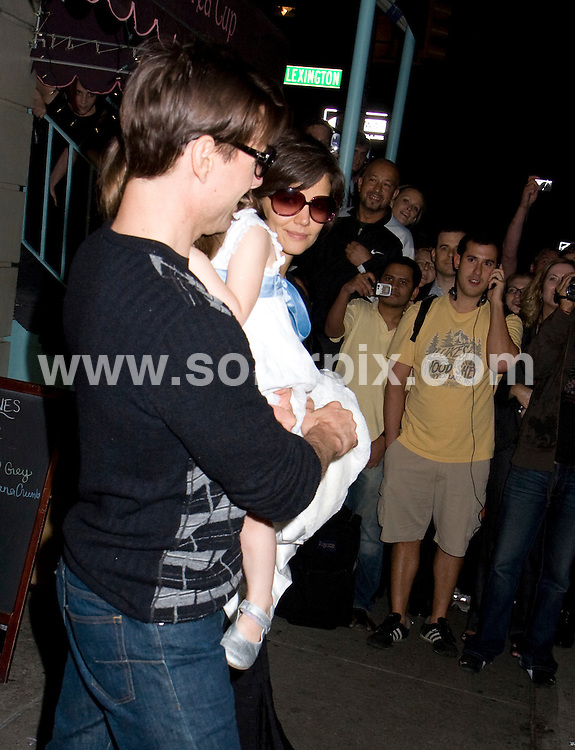 **ALL ROUND PICTURES FROM SOLARPIX.COM**.**SYNDICATION RIGHTS FOR UK, SPAIN, PORTUGAL, AUSTRALIA, S.AFRICA & DUBAI (U.A.E) ONLY**.Tom Cruise and Katie Holmes Take Daughter Suri Cruise to Alice's Tea Cup in New York, USA. September 29, 2008..This pic: Tom Cruise, Katie Holmes and Suri Cruise..JOB REF: 7493 PHZ (J Mayer)   DATE: 29_09_2008.**MUST CREDIT SOLARPIX.COM OR DOUBLE FEE WILL BE CHARGED* *UNDER NO CIRCUMSTANCES IS THIS IMAGE TO BE REPRODUCED FOR ANY ONLINE EDITION WITHOUT PRIOR PERMISSION*