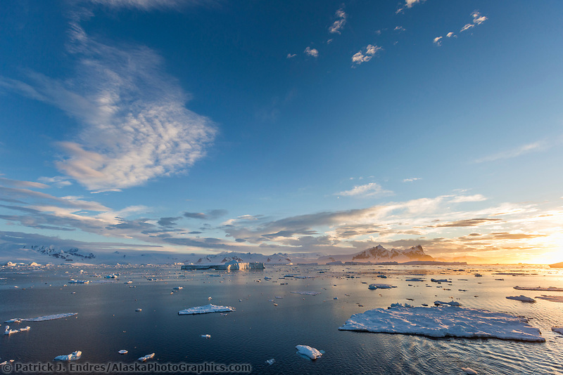 Colorful late evening sunlight on the floating ice in the waters of Crystal Sound, Antarcic peninsula.