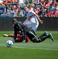 New York midfielder Joel Lindpere (20) and Chicago goalkeeper Sean Johnson (25) watch as Lindpere's shot rolls into the goal for New York's only score.  The Chicago Fire tied the New York Red Bulls 1-1 at Toyota Park in Bridgeview, IL on June 26, 2011.