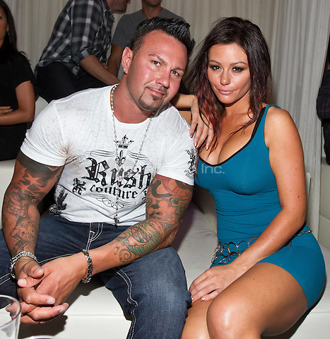 Roger Matthews and jenni 'JWoww' Farley pictured as Jenni 'JWoww' Farley hosts at PURE NIGHTCLUB at Caesars Palace in Las Vegas, NV on August 26, 2011. © Erik Kabik / MediaPunch.***HOUSE COVERAGE***