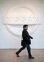 February 10, 2016, Yokohama, Japan - A visitor walks past a Nissan logo inside the Nissan Motor Company Ltd. showroom in Yokohama, south of Tokyo. Nissan booked a 34 percent rise in the company's group net profit to 452.8 billion yen and sold a total of 3,891,000 vehicles worldwide during the April-December 2015 period. (Photo by AFLO)