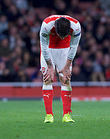 Hector Bellerin of Arsenal looks dejected after conceding another goal during the UEFA Champions League round of 16 match between Arsenal and Bayern Munich at the Emirates Stadium, London, England on 7 March 2017. Photo by Alan  Stanford / PRiME Media Images.