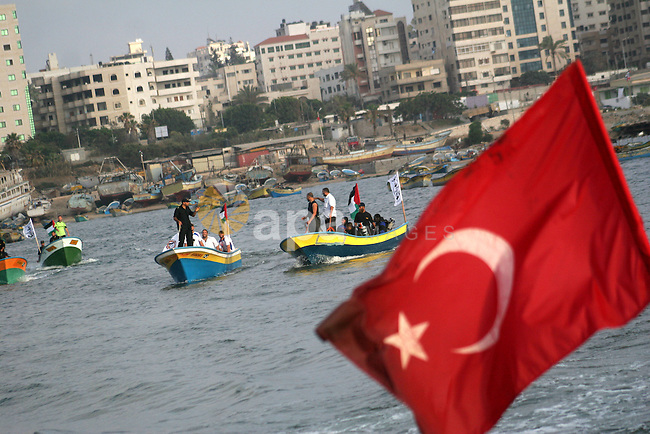 The Turkish flag flutters as Hamas marine security take to the open waters from Gaza City port on May 28, 2010 a day before the expected arrival of a flotilla of hundreds of pro-Palestinian activists trying to break a 3-year blockade of the Gaza Strip. Two cargo ships and five smaller boats loaded with thousands of tonnes of supplies and hundreds of passengers will be delayed by a day until May 29, organisers said, before they embark on the final leg of their attempt to bust the Gaza Strip embargo, a bid Israel vowed to defeat. Photo by Ashraf Amra