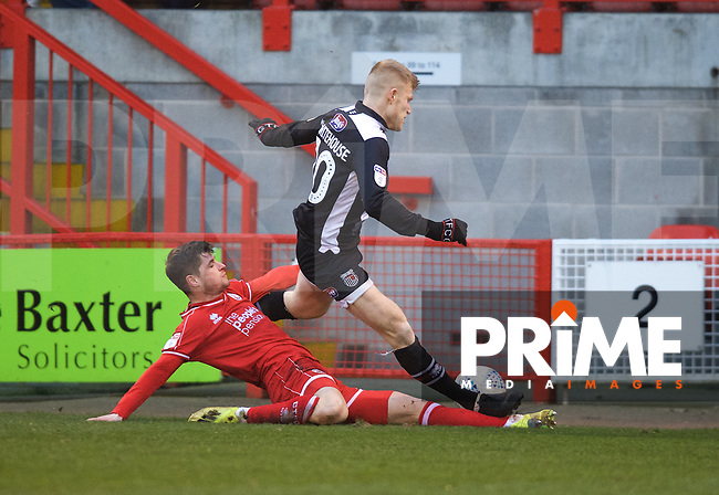 Elliott Whitehouse of Grimsby Town is tackled by Josh Doherty of Crawley Town during the Sky Bet League 2 match between Crawley Town and Grimsby Town at The People's Pension Stadium, Crawley, England on 25 January 2020. Photo by Alan  Stanford / PRiME Media Images.