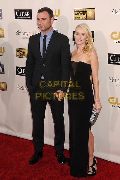 Liev Schreiber, Naomi Watts.18th Annual Critics' Choice Movie Awards - Arrivals held at Barker Hangar, Santa Monica, California, USA, .10th January 2013 .full length suit couple strapless black dress sheer v mesh  clutch bag holding hands slit split strappy sandals suit  blue black suit tie shirt  beard facial hair .CAP/ADM/BP.©Byron Purvis/AdMedia/Capital Pictures.