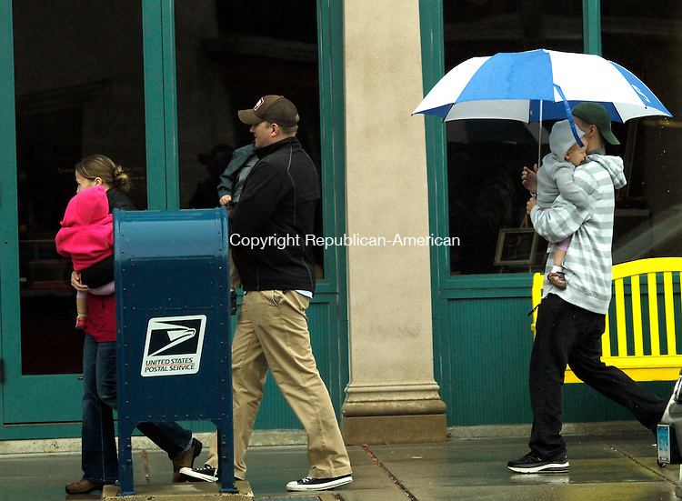 Torrington, CT-22 April 2012-042212CM02-  Concert goers make their way to the Warner Theatre to watch The Laurie Berkner Band Sunday afternoon in downtown Torrington.  Heavy rain fell in the area and according to the National Weather Service, Monday we can expect showers before 8am. Otherwise it will be mostly cloudy, with a high near 58.   Christopher Massa Republican-American