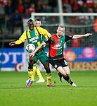 Nederland, Nijmegen, 5 oktober 2012.Eredivisie.Seizoen 2012-2013.N.E.C.-ADO Den Haag.Kenneth Omeruo (l.) van ADO Den Haag en Melvin Platje (r.) van N.E.C. strijden om de bal.