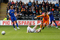 Oli McBurnie of Swansea City (C) slides in an attempt to score but fails in front of Dean Gerken of Ipswich Town during the Sky Bet Championship match between Swansea City and Ipswich Town at the Liberty Stadium, Swansea, Wales, UK. Saturday 06 October 2018