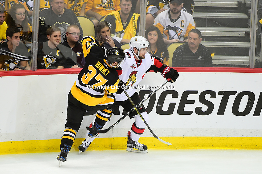 May 21, 2017: Pittsburgh Penguins right wing Carter Rowney (37) and Ottawa Senators defenseman Chris Wideman (6) battle along the glass during game five of the National Hockey League Eastern Conference Finals between the Ottawa Senators and the Pittsburgh Penguins, held at PPG Paints Arena, in Pittsburgh, PA. Pittsburgh shuts out Ottawa 7-0 to lead the series 3-2.  Eric Canha/CSM