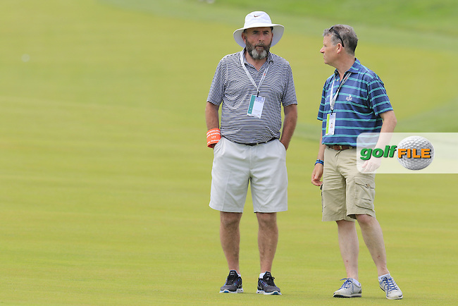 Shane Lowry's (IRL) dad Brendan and RTE's Greg Allen at the 10th green during Wednesday's Practice Day of the 2016 U.S. Open Championship held at Oakmont Country Club, Oakmont, Pittsburgh, Pennsylvania, United States of America. 15th June 2016.<br /> Picture: Eoin Clarke | Golffile<br /> <br /> <br /> All photos usage must carry mandatory copyright credit (&copy; Golffile | Eoin Clarke)