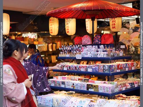 Japanese women in kimonos looking at a souvenir store display with Japanese hair pins and accessories. Matsubara dori street near Kiyomizu-dera. Higashiyama, Kyoto, Japan 2017.