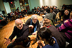 "Marty Keltz (L) and Larry Winters (C), Vietnam Veteran and author of ""The Making and Un-Making of A Marine,"" talk with participants in the Veteran-Civilian Dialogue at Intersections International on February 4, 2011 in New York City.  (PHOTOGRAPH BY MICHAEL NAGLE)"