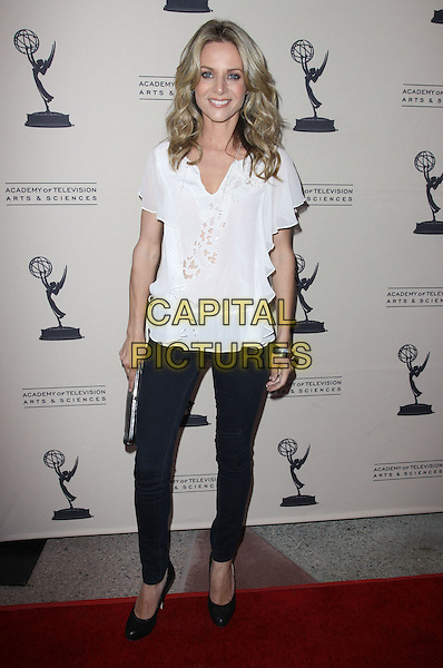 JESSALYN GILSIG .An evening with 'GLEE' held At Leonard H. Goldenson, North Hollywood, California, USA, 26th April 2010..full length white top skinny denim jeans shoe black navy shoes clutch bag .CAP/ADM/KB.©Kevan Brooks/AdMedia/Capital Pictures.