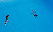 Una nina se zambulle en la piscina de clavados de las Piscinas Panamericanas durante entrenamientos de la liga de natacion del Valle del Cauca antes de finales de natacion durante los Juegos Deportivos Nacionales en Cali, Valle del Cauca, Colombia, jueves 8 de noviembre 2012..Foto: Coldeportes/Archivolatino..COPYRIGHT: Coldeportes. Imagen distribuida por el servicio gratuito de difusiÛn de los Juegos Deportivos Nacionales 2012. Prohibida su venta y su uso comercial.