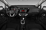 Stock photo of straight dashboard view of 2016 KIA Rio LX 5 Door Hatchback Dashboard