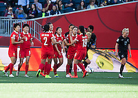 WINNIPEG, MANITOBA, CANADA - June 15, 2015: The Woman's World Cup China vs New Zealand match at the Winnipeg Stadium.  Final score China 2, New Zealand 2.