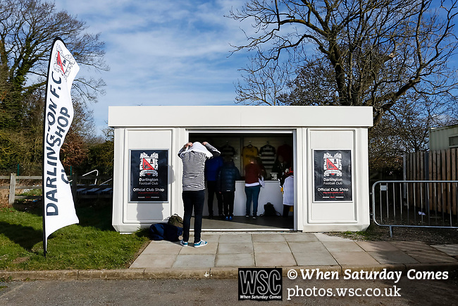 A Darlington fan trying on a newly purchased shirt from the club shop. Darlington 1883 v Southport, National League North, 16th February 2019. The reborn Darlington 1883 share a ground with the town's Rugby Union club. <br />