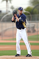 Pat Egan #52 of the Milwaukee Brewers participates in pitchers fielding practice during spring training workouts at the Brewers complex on February 18, 2011  in Phoenix, Arizona. .Photo by Bill Mitchell / Four Seam Images.