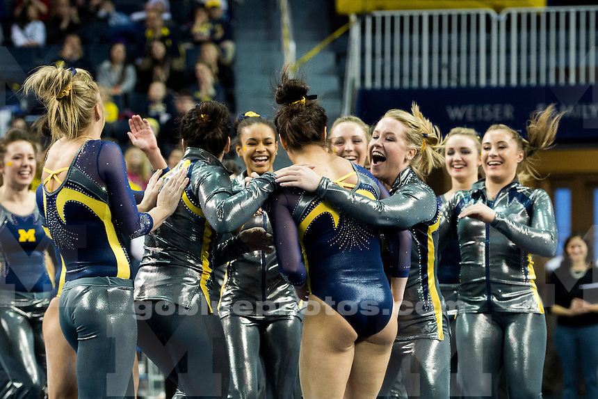 The University of Michigan women's gymnastics team defeats Illinois, 196.850-195.475, at Crisler Center in Ann Arbor, Mich. on January 25, 2015.