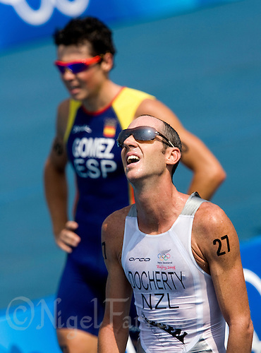 19 AUG 2008 - BEIJING, CHN - 2004 Olympic Gold Medallist Bevan Docherty (NZL) (front) finishes in third place ahead of ace favourite Javier Gomez (ESP)(back) - Mens Triathlon - Beijing Olympics. (PHOTO (C) NIGEL FARROW) *** IOC RULES APPLY ON USAGE ***