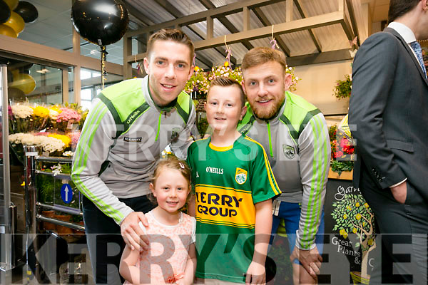 Marc O'Se and Barry John Keane  meet a young fans Brandon and Amber Healy at the official opening of the new look Garveys Super Valu on Rock Street on Thursday